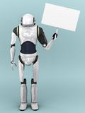 Artificial robot holding sign. Royalty Free Stock Image
