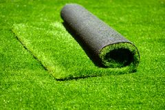 Artificial rolled green grass Stock Images