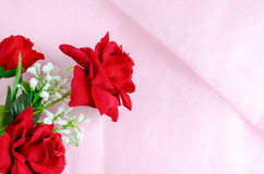 Artificial rose bouquet on pink background Royalty Free Stock Photography