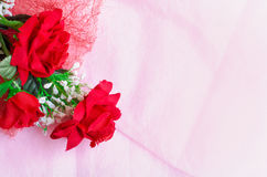 Artificial rose bouquet on pink background Stock Photo
