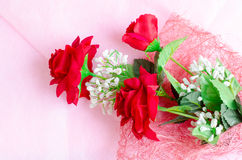 Artificial rose bouquet on pink background Stock Image