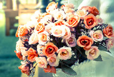 Artificial rose bouquet in vintage filtered. Stock Photo