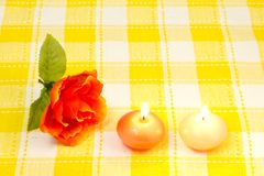 Artificial rose and candles royalty free stock photos