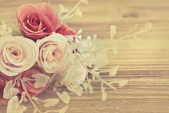 Artificial Rose flower. On vintage style background Stock Photos