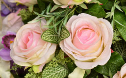 Artificial rose flowers on nature background Stock Photo