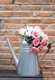 Artificial rose in metal vase. Royalty Free Stock Photos