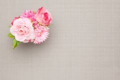 Artificial rose on the table cloth. This is a photograph of artificial rose on the table cloth Stock Photos