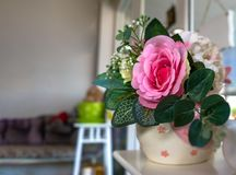 Artificial Rose in the vase decorating Stock Photo