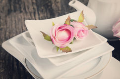Artificial rose in white plate Royalty Free Stock Image