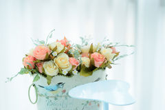 Artificial roses in the basket Royalty Free Stock Photography