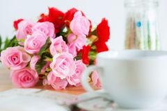 Artificial roses bouquet on the desk Stock Photos