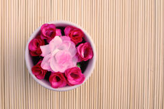 Artificial roses in bowl Stock Photography