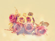 Artificial roses flower bouquet with vintage filter color Stock Image