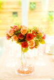 Artificial roses in glass vase Royalty Free Stock Photography