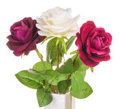 Artificial roses isolated. Artificial roses in vase isolated Royalty Free Stock Image