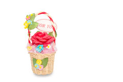 Artificial roses in rattan basket on white background Royalty Free Stock Images