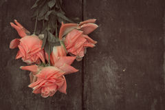 Artificial roses on a wooden floor. Royalty Free Stock Photo