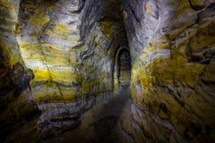 Artificial sandstone cave. Stock Photo
