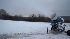 Artificial snow production by snow gun stock footage