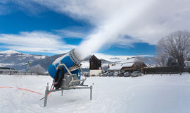 Artificial snow on ski resort at cold day in Alps Stock Image