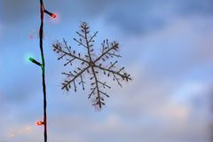 Artificial snowflake on the glass. stock photography