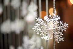 Artificial snowflakes in white snow Stock Photos