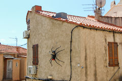Artificial spider on a building. Royalty Free Stock Photos