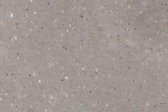 Artificial stone quartz agglomerate cream gloss texture. royalty free stock image