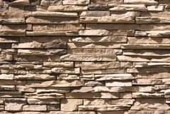 Artificial Stone Wall. Background with bright sunlight and shadows Royalty Free Stock Photos