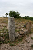 Artificial stony pillars in the ruins of the medieval fortress Funa. Royalty Free Stock Photos