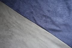 Artificial suede in blue and grey sewn aslant. Artificial suede in blue and gray sewn aslant Royalty Free Stock Photo