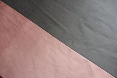 Artificial suede in grey and pink sewn aslant. Artificial suede in gray and pink sewn aslant Stock Photography