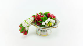 Artificial temple flower garland on tray with pedestal Stock Image