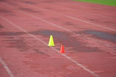 Artificial track and field with green grass combined with artificial grass royalty free stock images