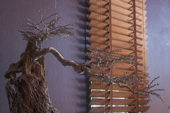 Artificial tree made of wire on stone. Decorate on work table Royalty Free Stock Photos