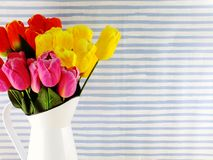 Artificial tulip flowers bouquet home decoration. Colorful of artificial tulip flowers bouquet home decoration with space background stock photo