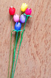 Artificial tulips flower made from silk cocoon on plywo Stock Images