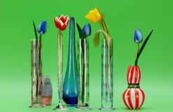 Artificial tulips in glass vases Stock Photography