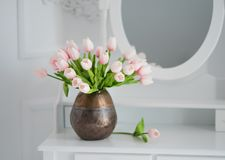 Artificial tulips on a table with a mirror Royalty Free Stock Images