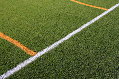 Artificial turf. Field, showing yellow and white lines Stock Image