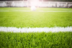 Artificial turf football field green white grid Stock Images