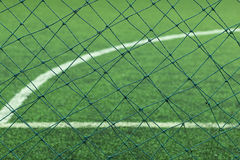 Artificial Turf of a Football. Artificial Turf of a Football with mesh barrier Stock Photo