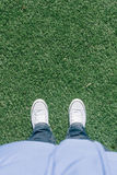 Artificial turf grass on soccer field with two shoes Stock Image