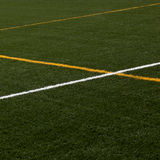 Artificial turf with marker stripes Royalty Free Stock Photo