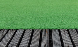 Artificial Turf and Old Wood Stock Photo