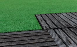 Artificial Turf and Old Wood Stock Photography