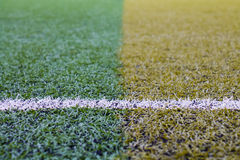 Artificial turf pattern with a line Royalty Free Stock Photo