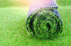 Artificial turf roll. For lawn laying royalty free stock photography