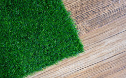 Artificial turf on wood tile Stock Photography