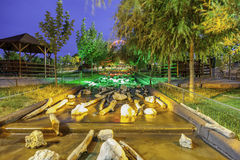 Artificial water fall. In the park. Long exposure at night. Colored lights Royalty Free Stock Image